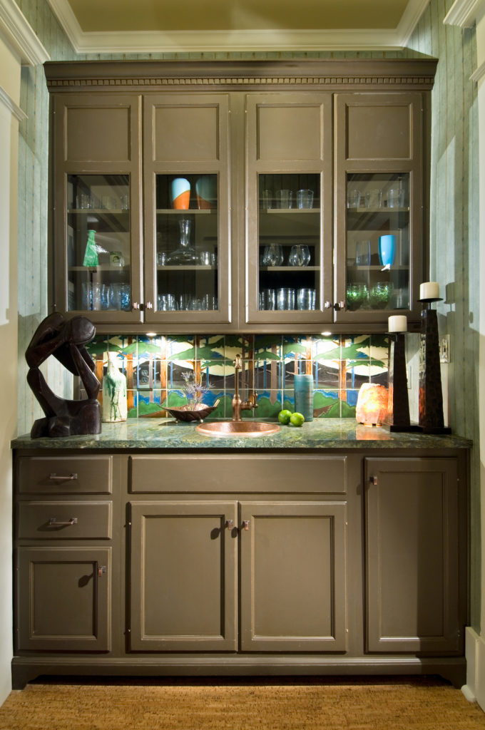 bar hutch with forest painted on backsplash
