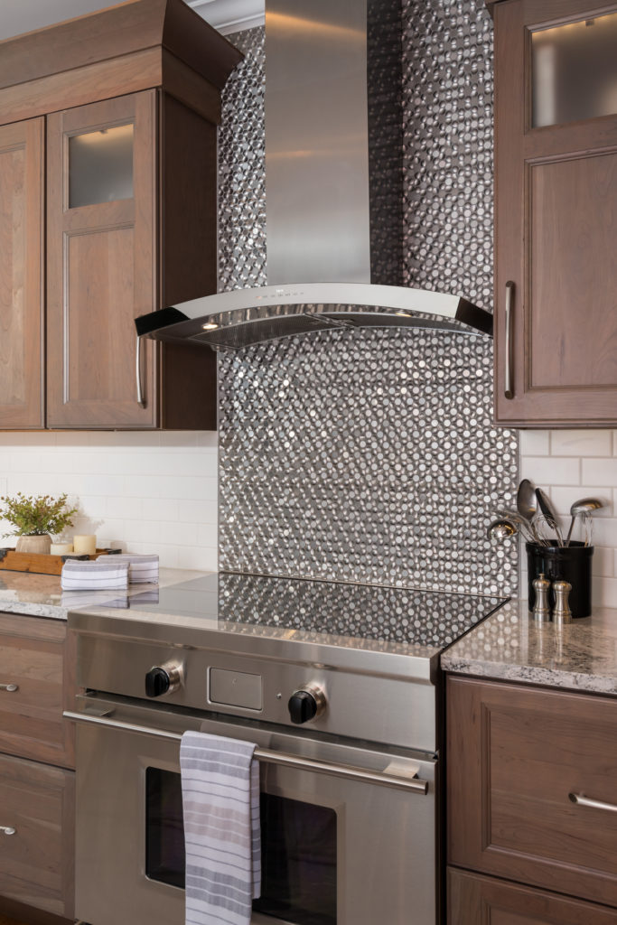 modern stainless steel cook top with hood